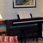 Piano beside two end tables with lamps on