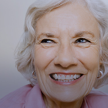 woman with a big smile looking off into the distance