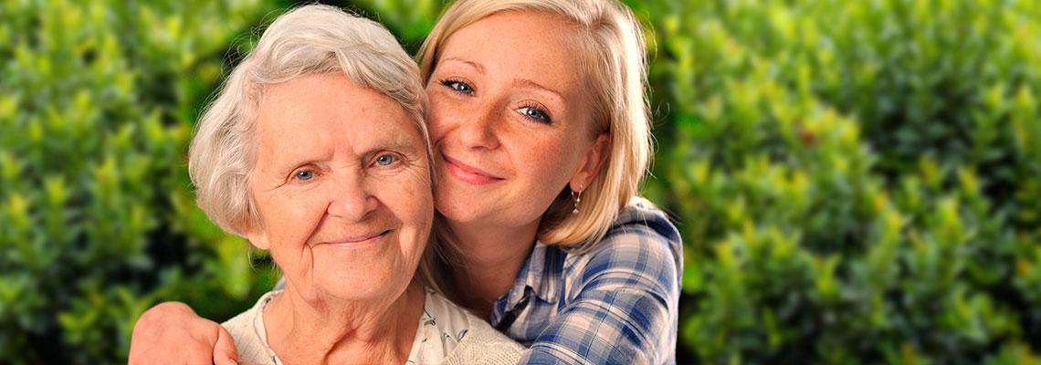 young woman giving her grandma a hug