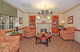Montevue elegantly appointed recreation room with walnut bookcases and a fireplace
