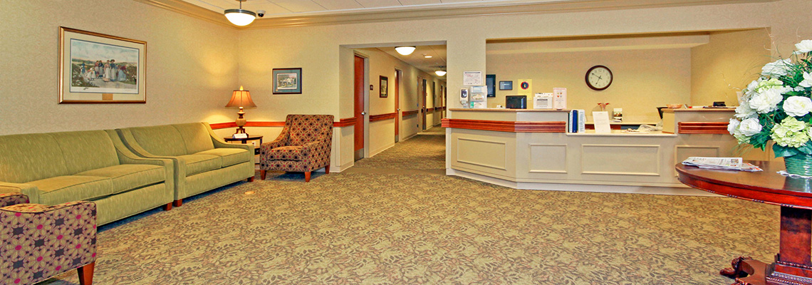 Lobby area with decorative carpet and comfortable seating