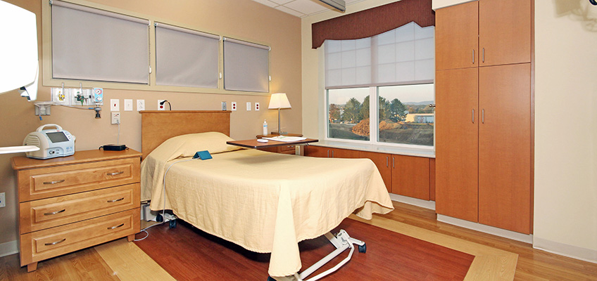 Resident room with clean floors and a window with nice coverings