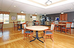 Resident dining room with beautiful wood floors