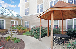 Outside gazebo with seating and walking paths