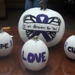 Painted pumpkins that read hope - love - cure