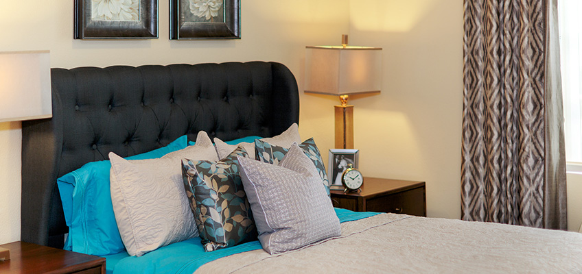 bed with night stand table and lamp