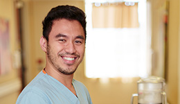 smiling male nurse golden background