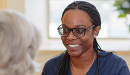 smiling african american nurse wearing glasses