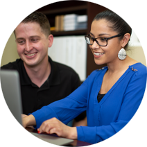 female business office manager smiling with coworker