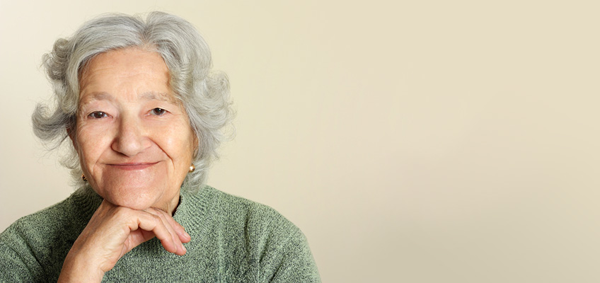 smiling older woman with her chin resting on her hand