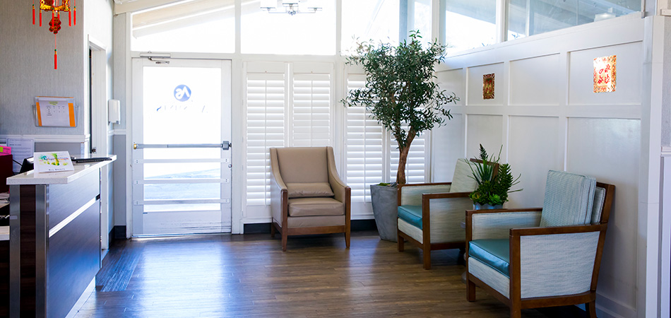 front lobby with live plants and comfortable seating