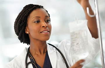 female medical professional administering an IV