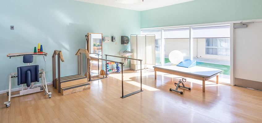 A rehab gym with weights and exercise balls