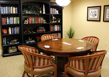 recreation room with books and game table