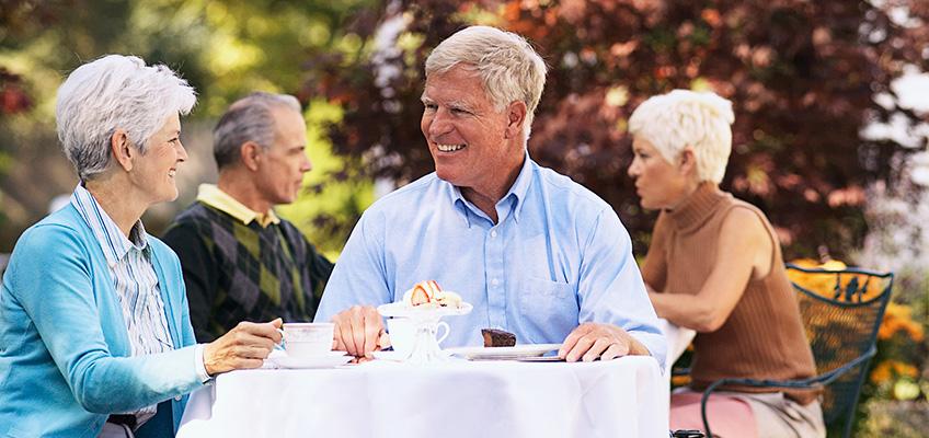 elderly couple drinking tea outside