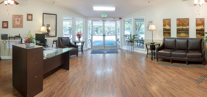 Front lobby with comfortable seating, clean wood floors and pleasant lighting