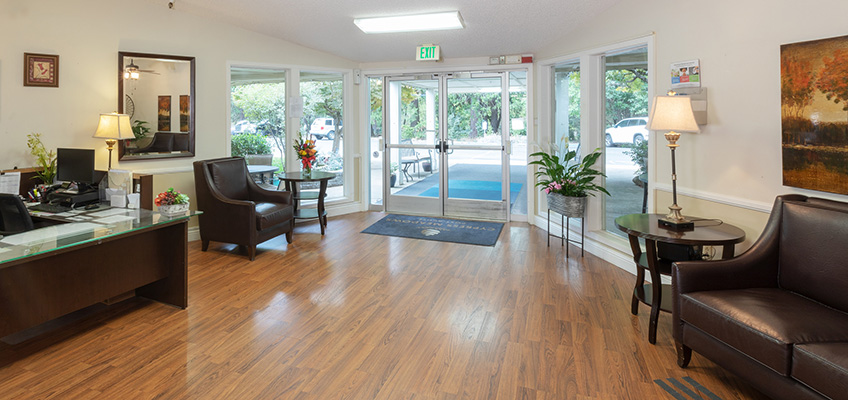 Welcoming lobby with comfortable seating and clean, wood floors