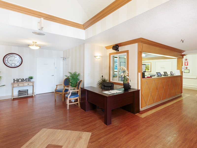 Lobby area beside the nursing station with very clean hardwood floors.