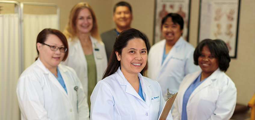 Primrose staff members standing together in a group smiling