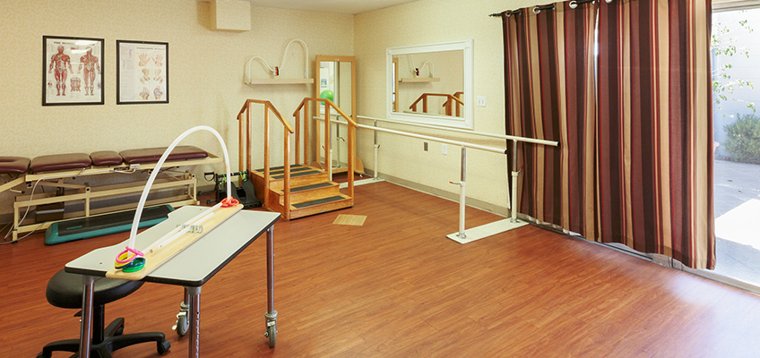 Nicely organized and clean rehabilitation room featuring ready to use equipment.