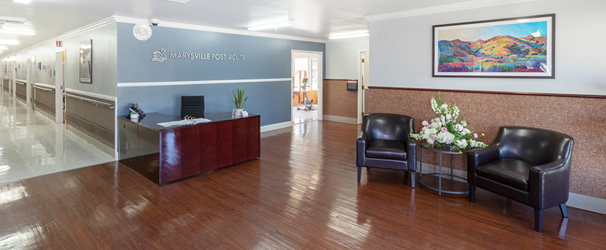 Front lobby with beautiful, clean wood floors and comfortable seating