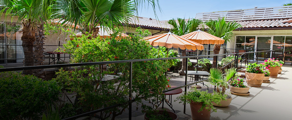 Pacific Palms outdoor patio with umbrellas and seating
