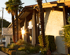 The sun shining on the exterior of Pacific Palms front entrance