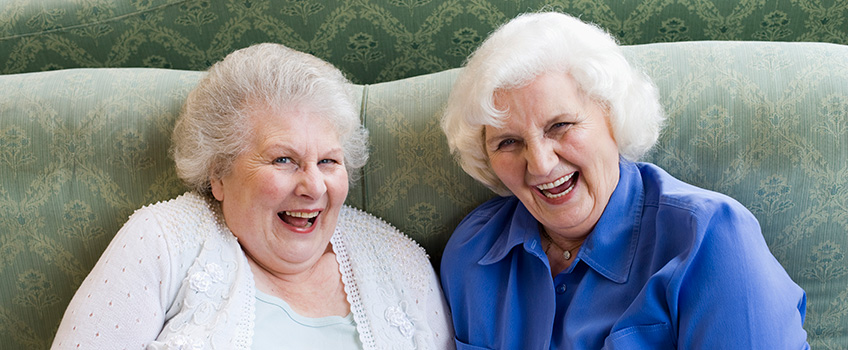 2 elderly females laughing