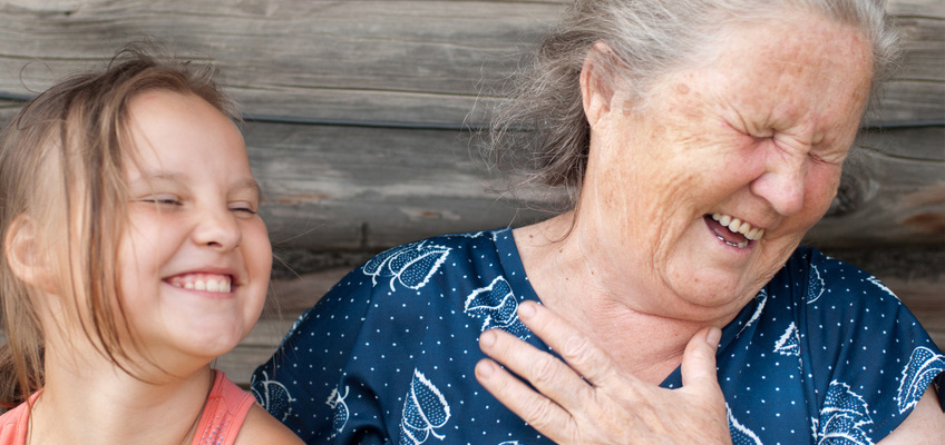 woman having a good laugh with her visiting granddaughter