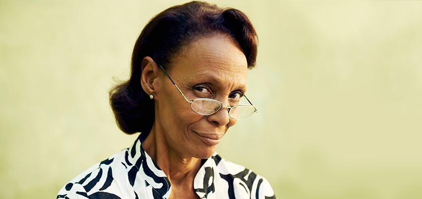 woman wearing glasses looking very pensive