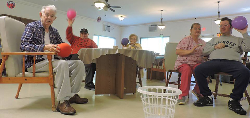 Residents playing a game of shoot the ball
