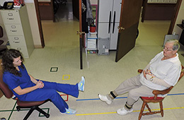 Resident performing rehabilitation exercises with a staff member
