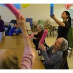 Residents playing a game of hit the balloon