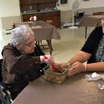 Barbara Salisbury and activity assist Mary Beth making cookies.