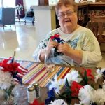 Delores Kendrick working on flower arranging.