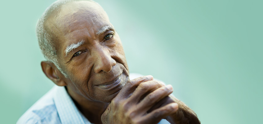 elderly man looking thoughtfully at the camera