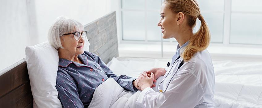resident having a heartfelt conversation with her caregiver