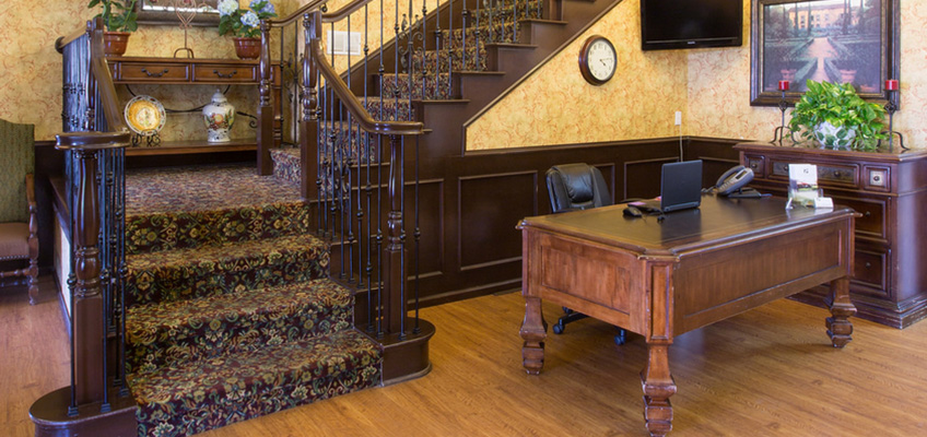 wooden desk and staircase in the lobby