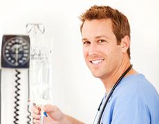 male nurse administering an IV