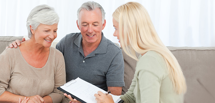 couple going over paperwork with staff member