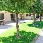 Sierra Vista outdoor patio with mature shade trees