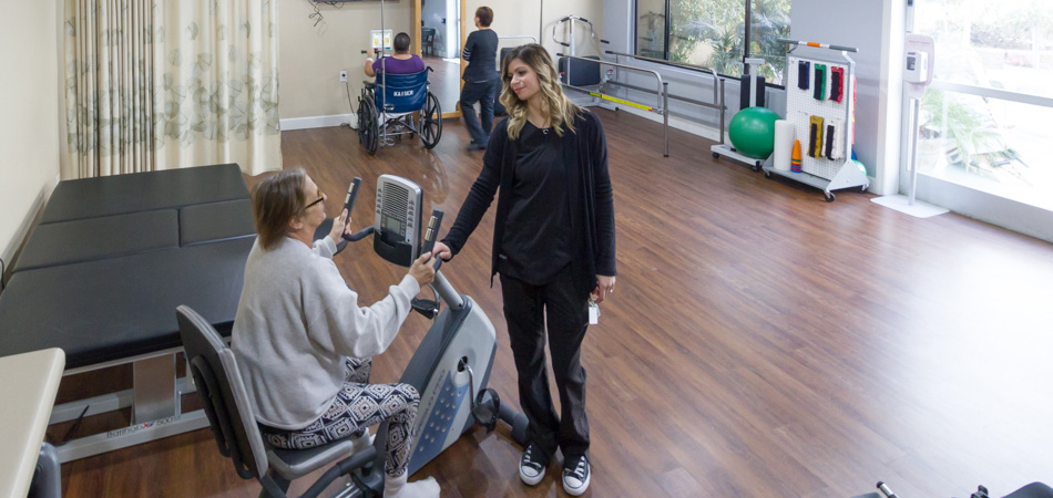 residents working in the therapy room with therapists
