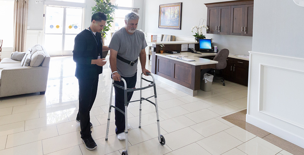 resident using a walker in the lobby