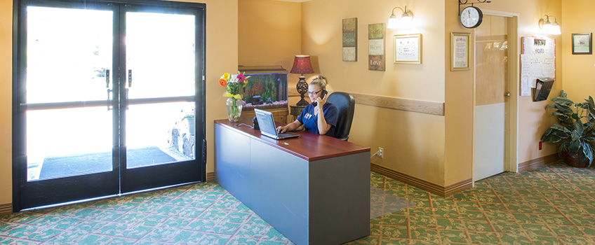front desk attendant in well lit lobby