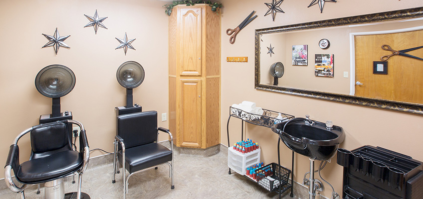 salon with hair dryers and sink