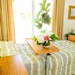 Resident room with a beautiful bouquet of flowers on the food tray