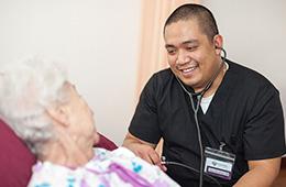 nurse taking residents blood pressure