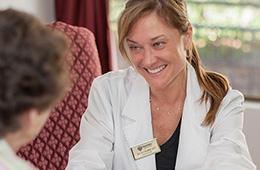 nurse smiling at resident