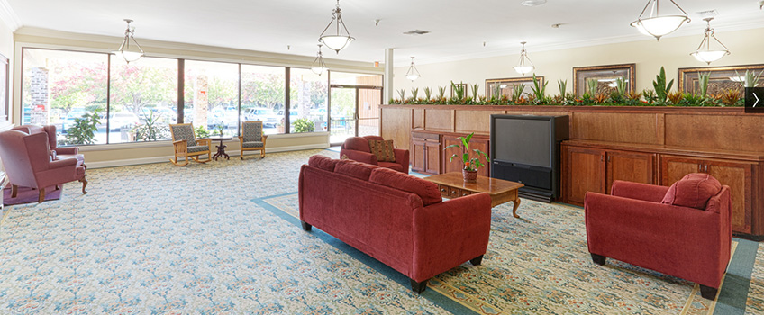 lobby area with couch and chairs
