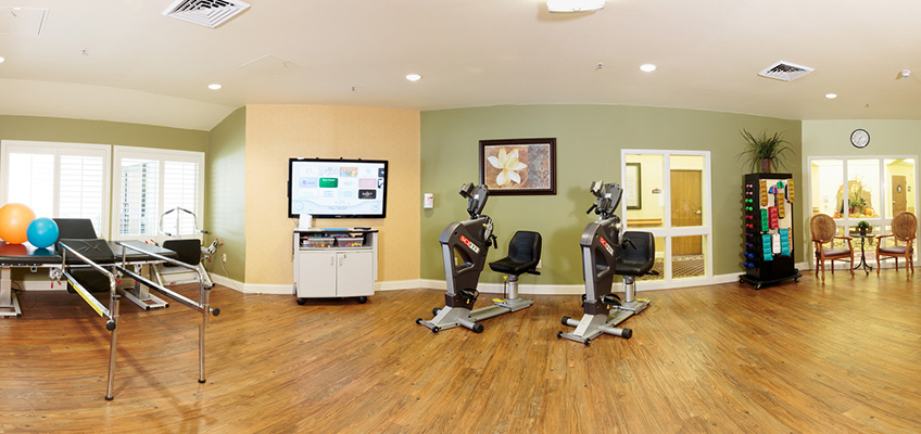 rehabilitation room with various pieces of equipment